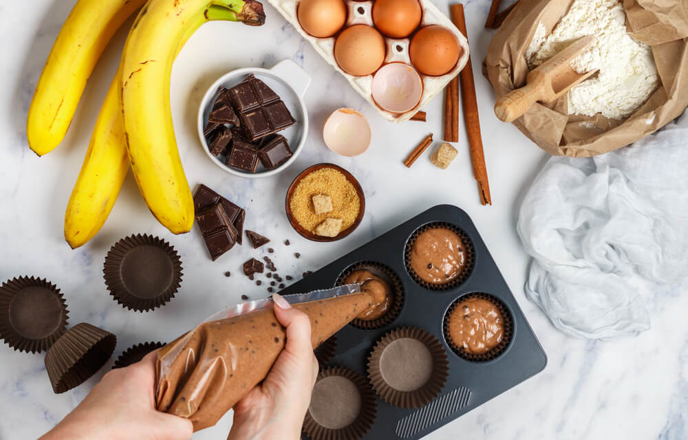 Woman baking banana muffins