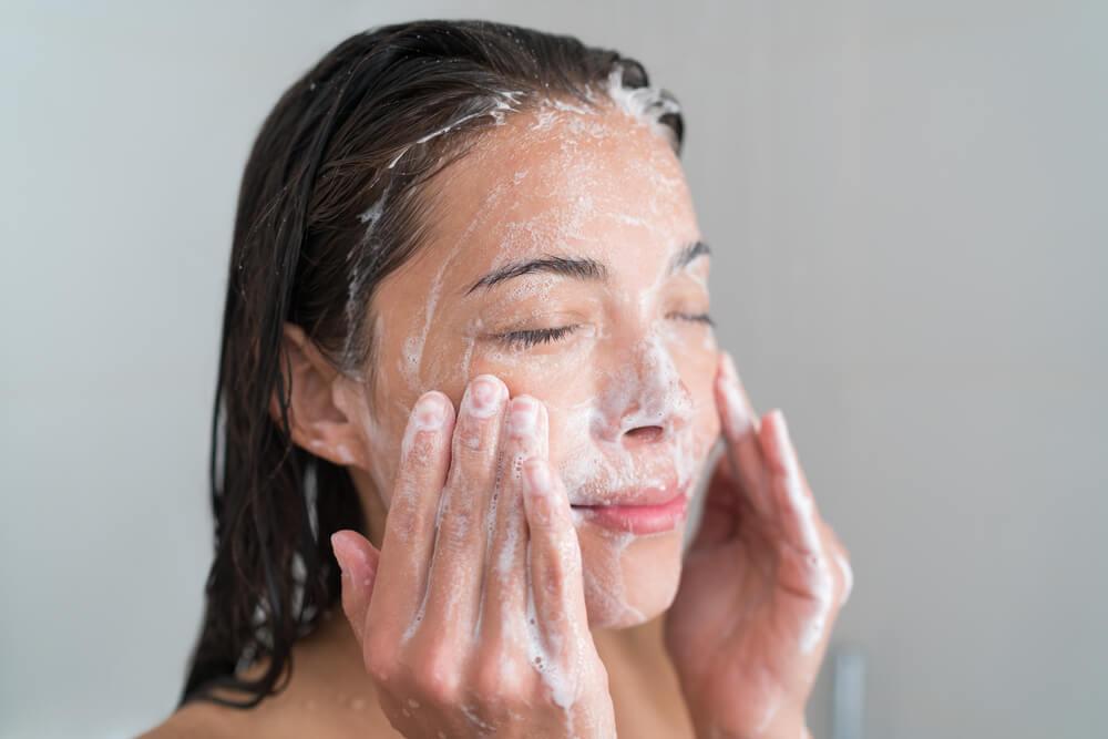 Woman cleansing skin