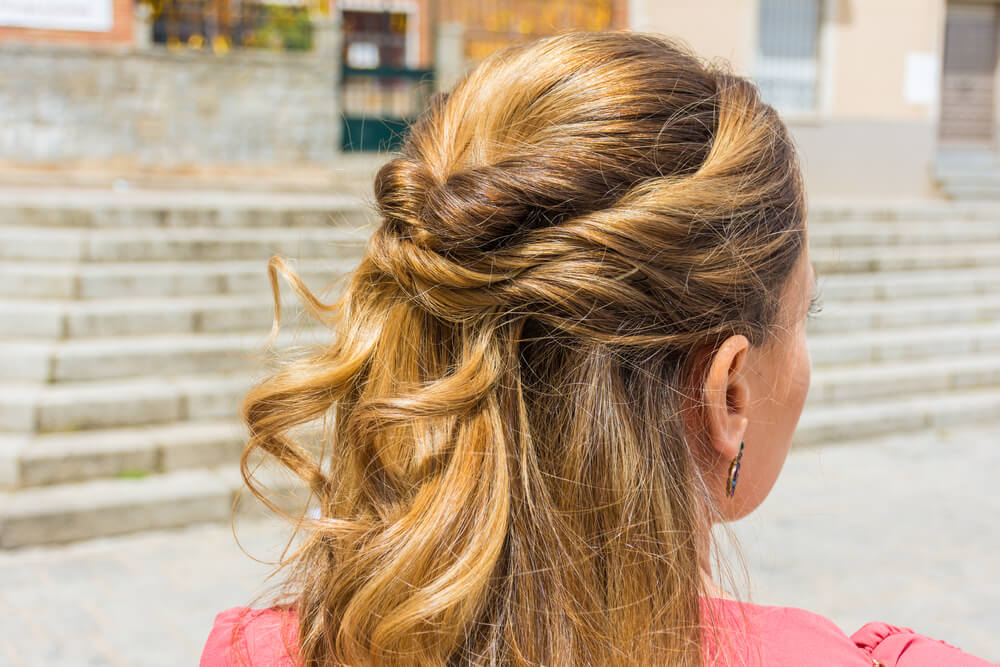 Woman with half up hairstyle