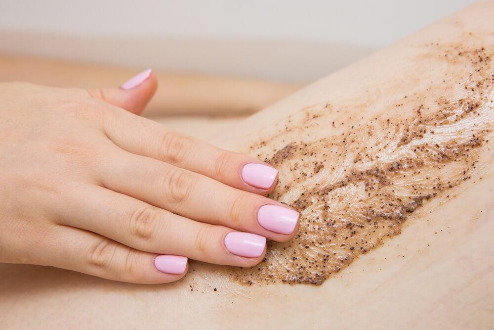 Applying body scrub to skin