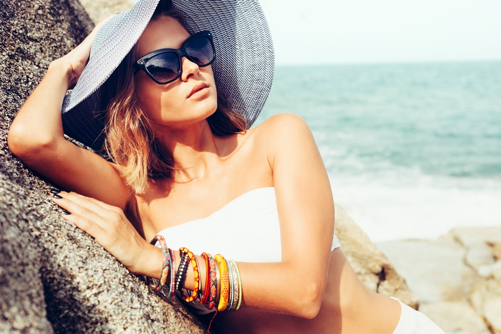 woman at beach with sunglasses