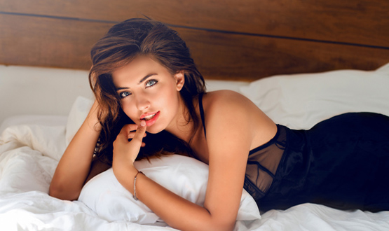 Beautiful woman lying in bed